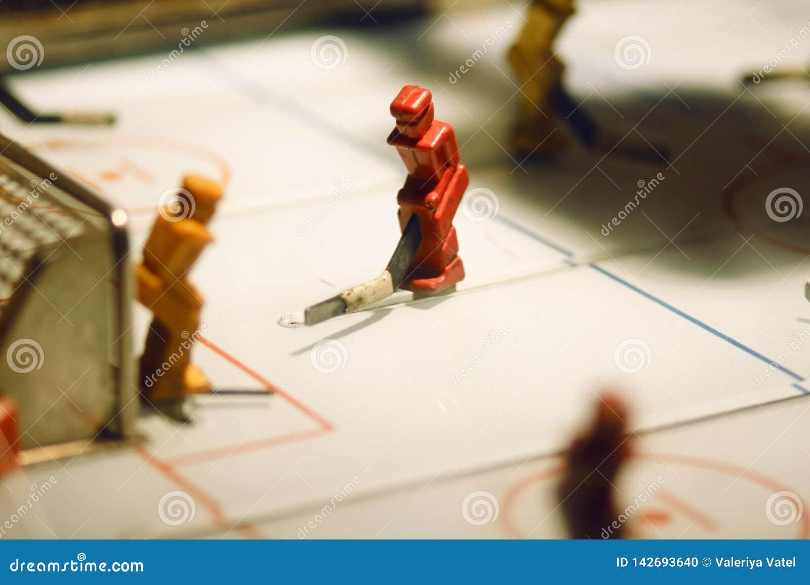 与曲棍球运动员图的台式游戏机