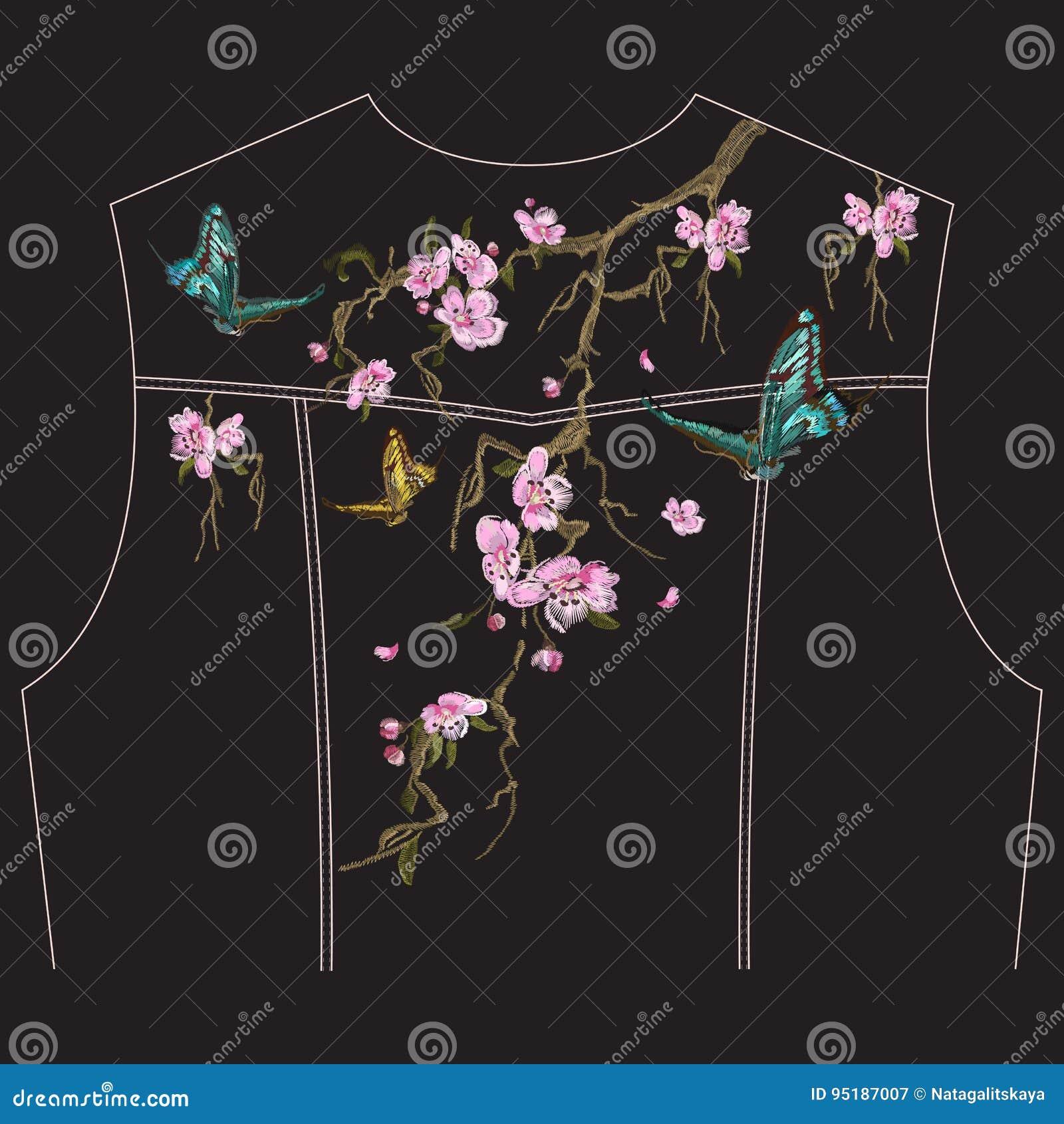 与樱花开花的刺绣花卉样式牛仔裤的