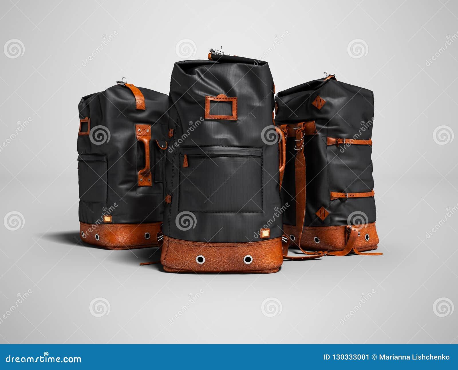 与皮革插入物的三个远足的黑袋子为周末
