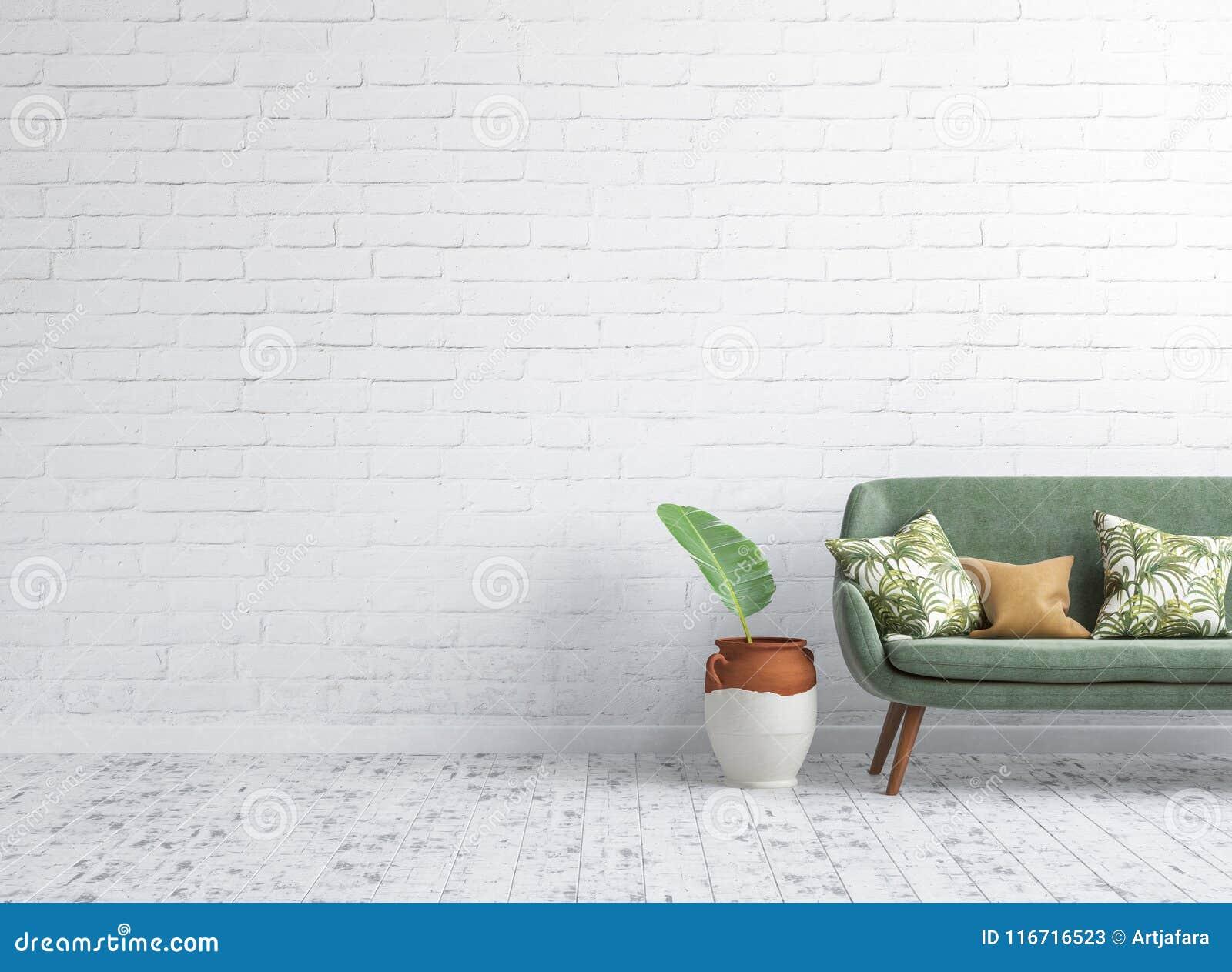 与绿色沙发的客厅内部在背景的白色砖墙嘲笑