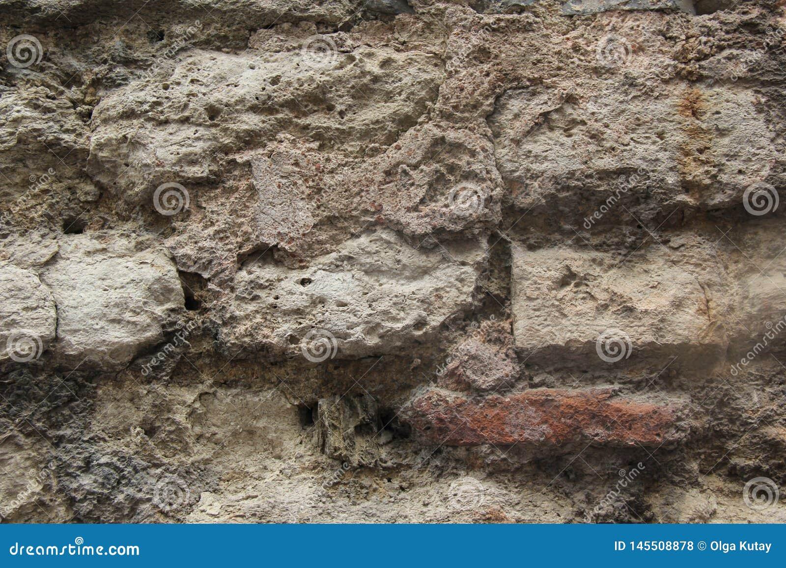 与落的膏药的用水泥涂的灰色石工