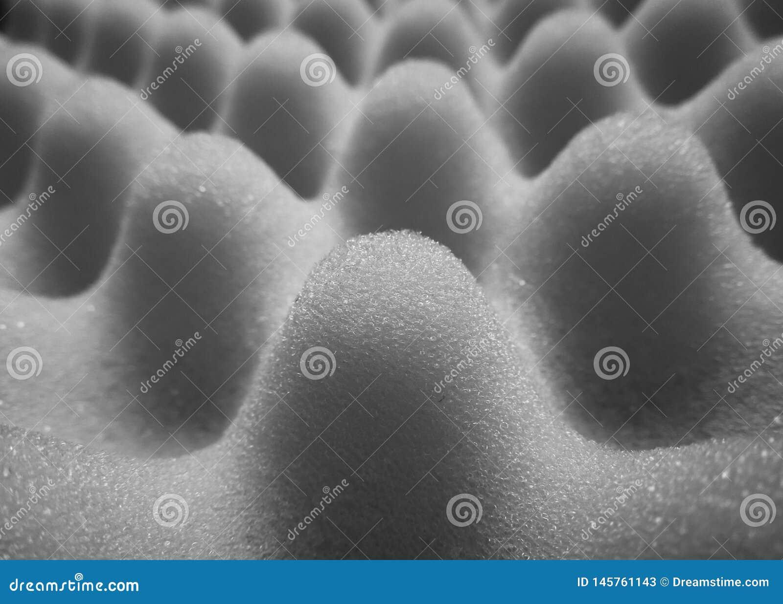 与起泡的海绵纹理的灰色和灰色背景