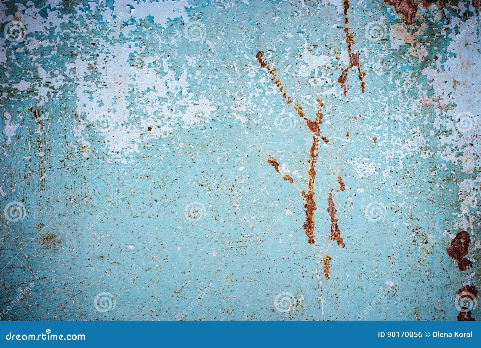 与难看的东西镇压的抽象蓝色褐色纹理 金属表面上的破裂的油漆 与概略的油漆转折的都市背景 T