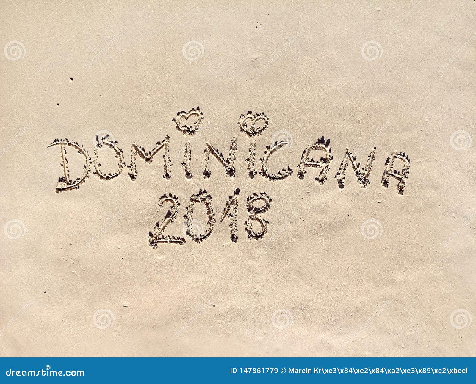 与题字的加勒比海滩在沙子 多米尼加共和国