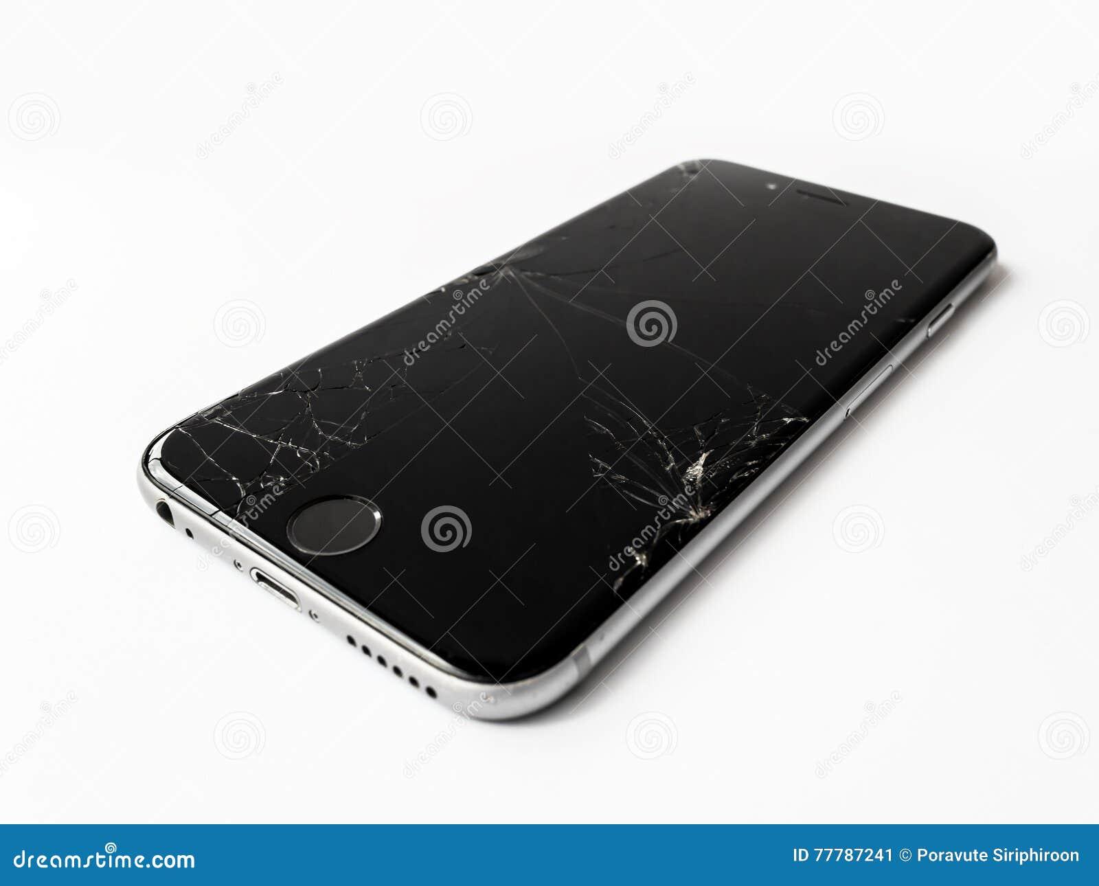 与破裂的屏幕的残破的苹果计算机iPhone 6
