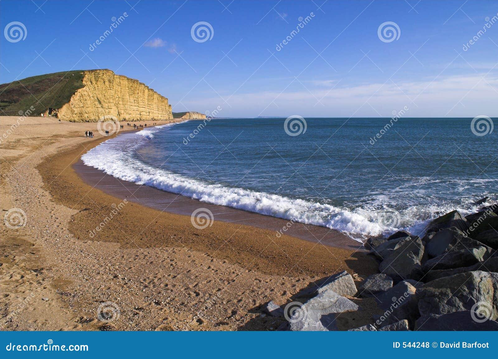 Download 东西方海湾的海滩 库存照片. 图片 包括有 人们, 天空, 外套, 海岸, 峭壁, 蓝色, 侏罗纪, 波特兰 - 544248
