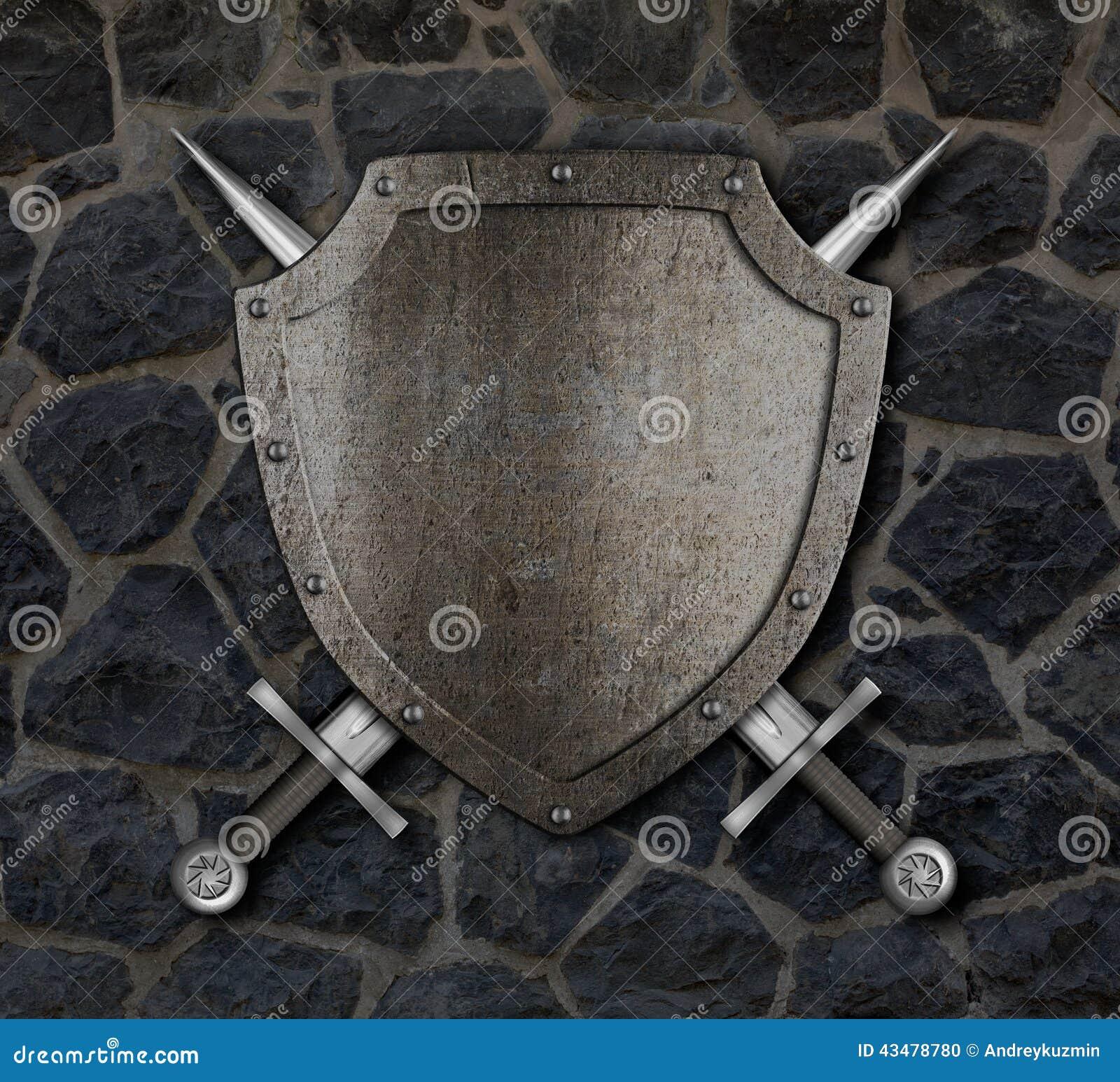 中世纪盾和横渡的剑在墙壁上