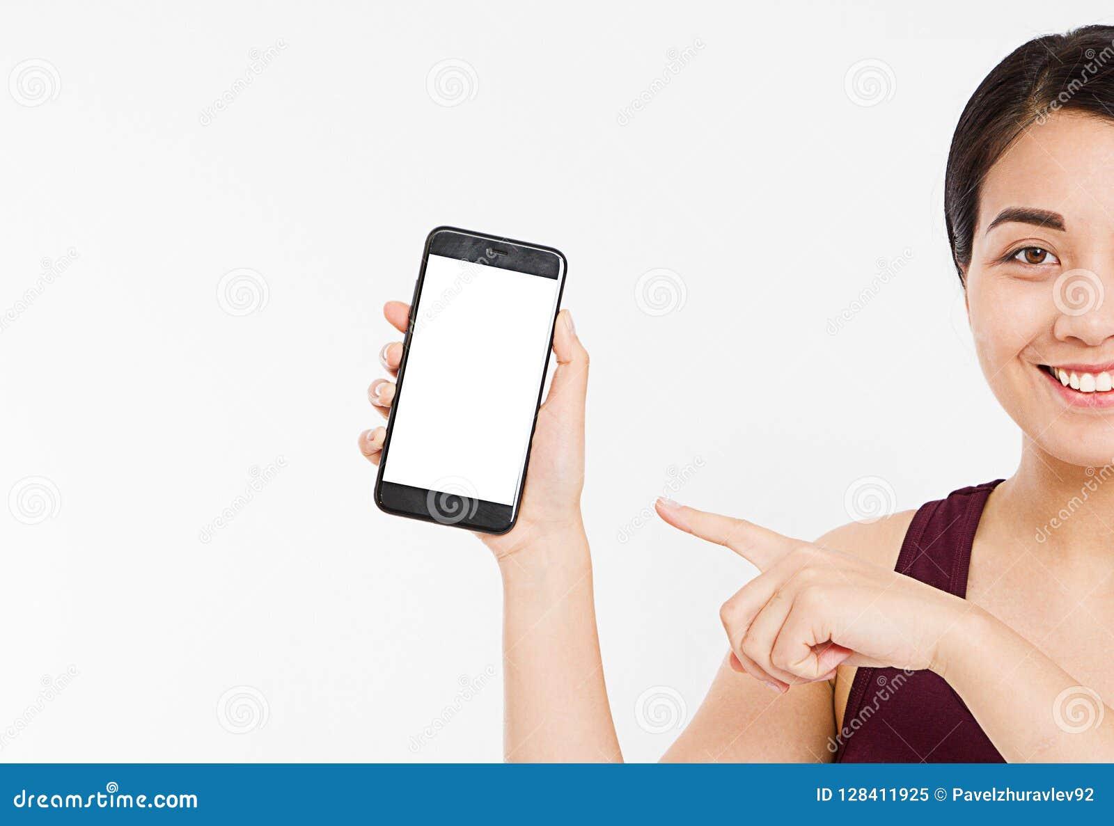 亚洲播种的画象,韩国妇女,女孩举行黑屏手机,指点隔绝在白色背景,手