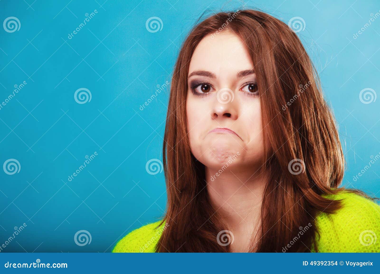 人概念-做傻的面孔的十几岁的女孩