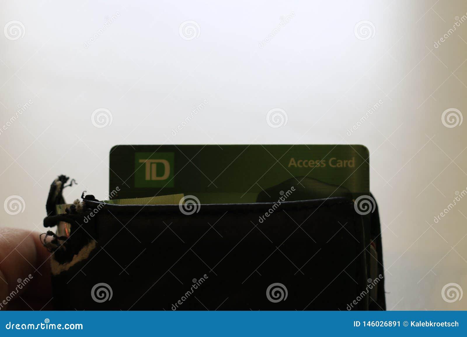 伦敦加拿大,2019年4月27日:黏附在钱包外面的道明加拿大信托银行商标的社论照片 多伦多统治银行是