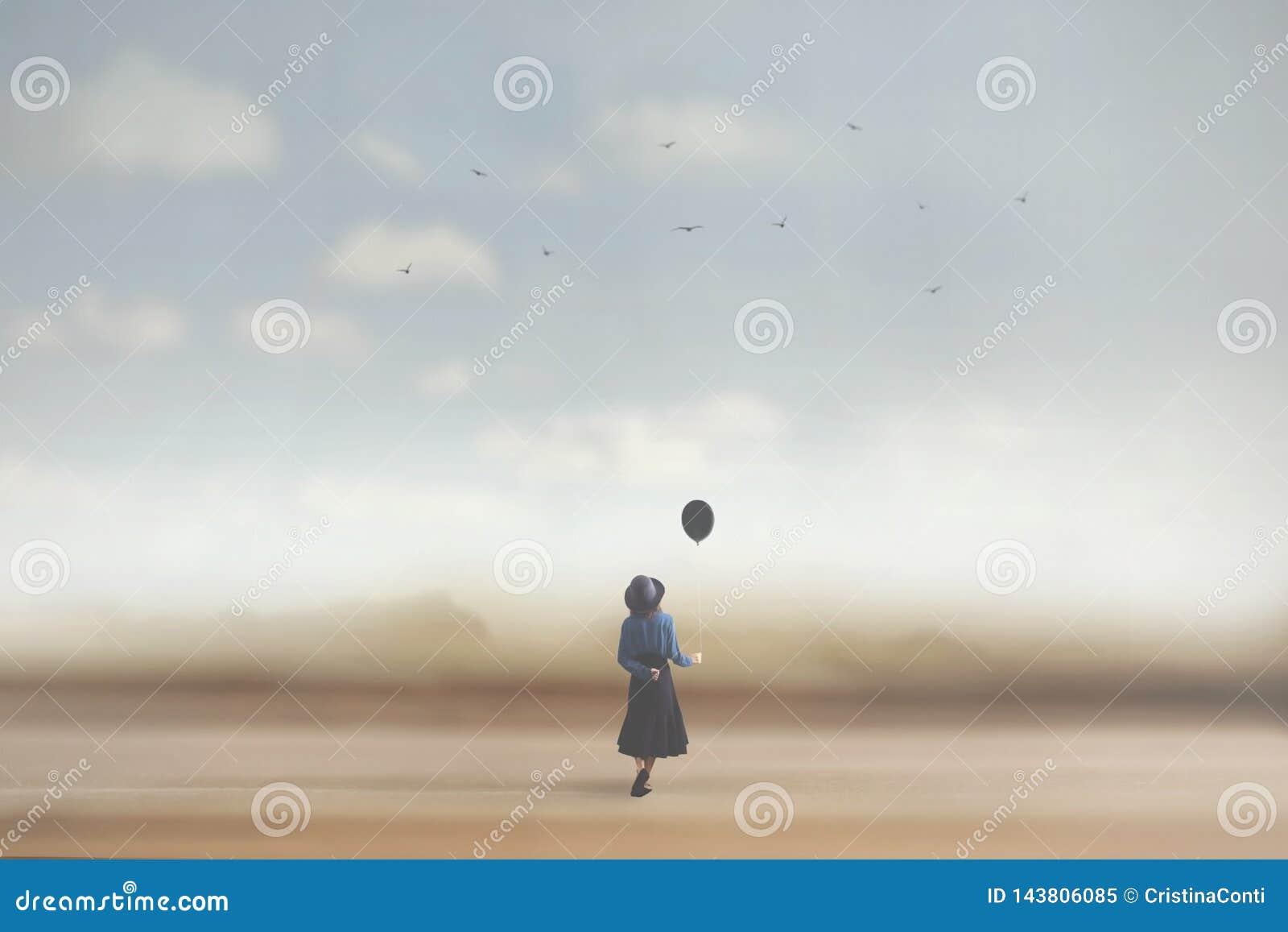 作梦与气球的年轻女人的超现实的图象