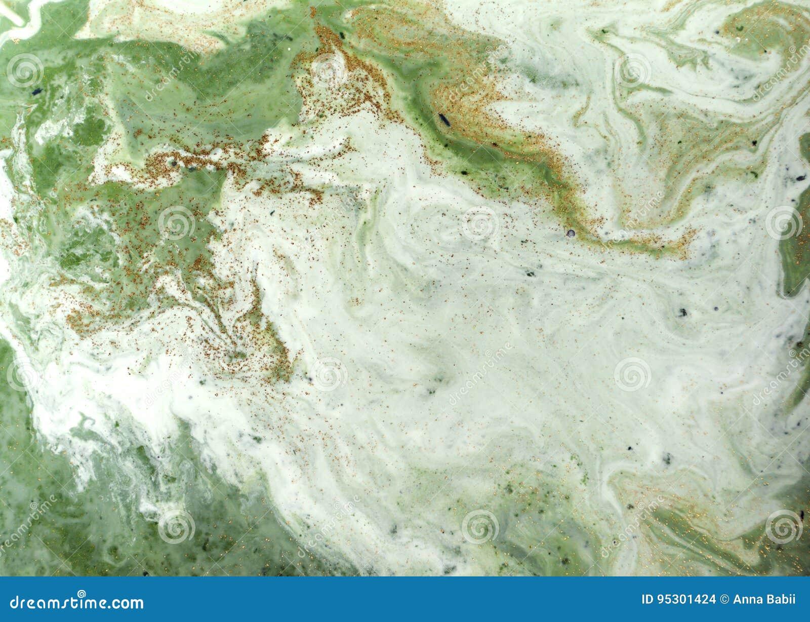 使有大理石花纹的绿色和金黄抽象背景 液体大理石样式