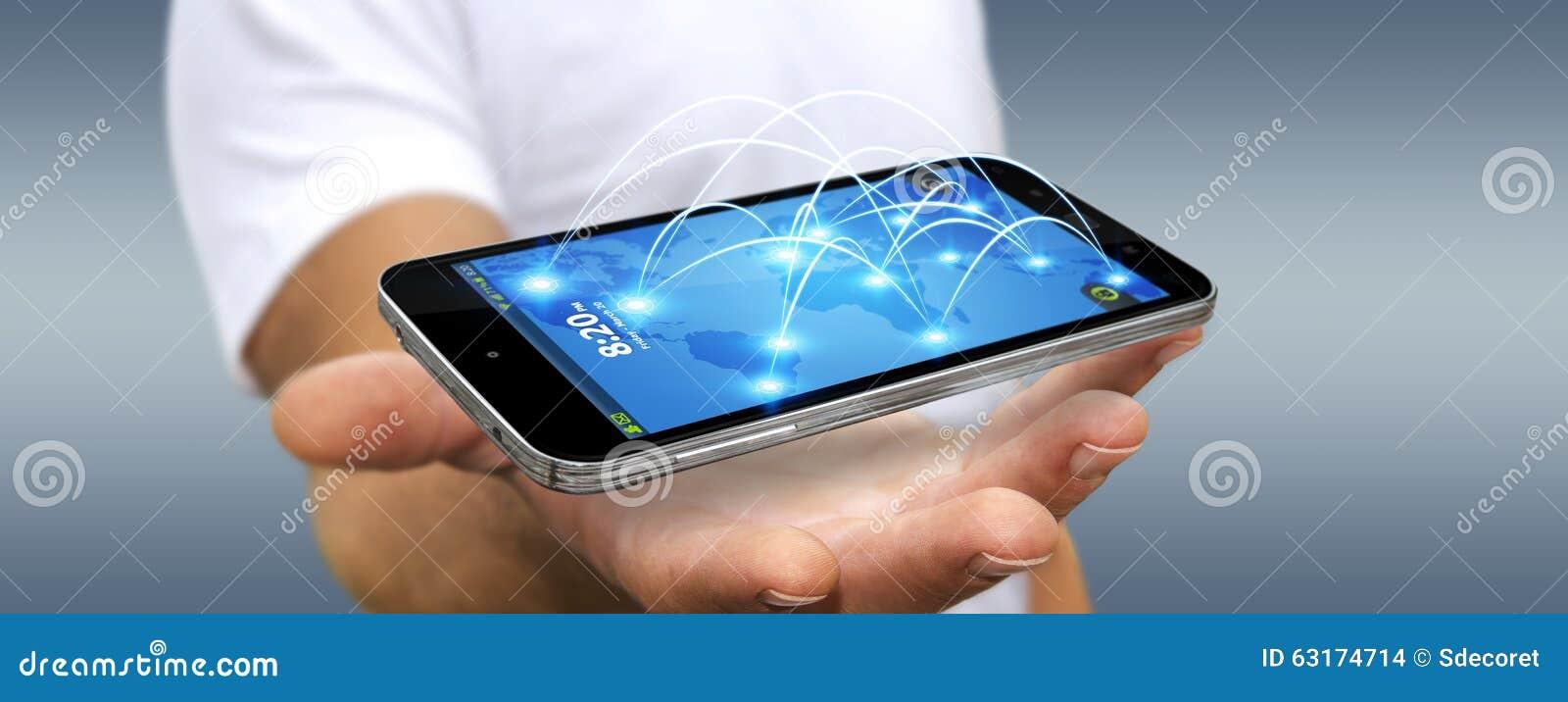 与连接世界的不同的地方的现代手机的商人.图片