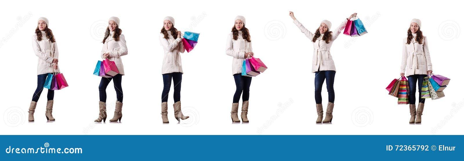 做圣诞节购物的冬天衣物的妇女