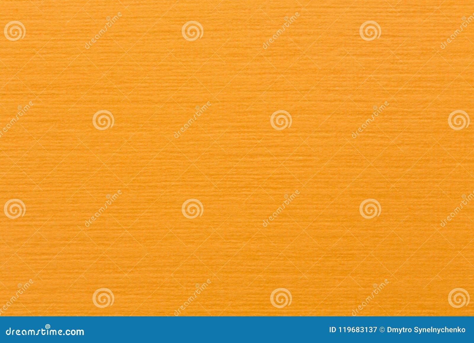 光滑的淡桔色的毛毡织品背景纹理顶视图