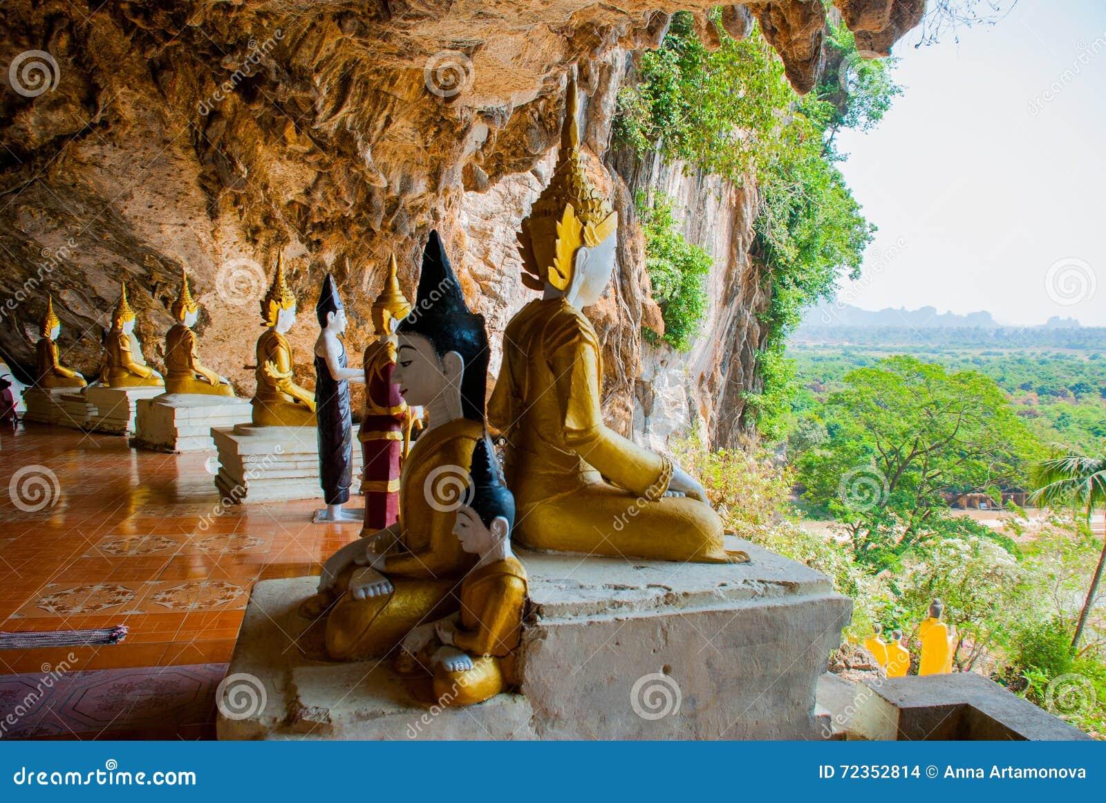 全部Buddhas雕象惊人的看法和宗教雕刻在神圣的洞的石灰石岩石 Hpa-An,缅甸 缅甸