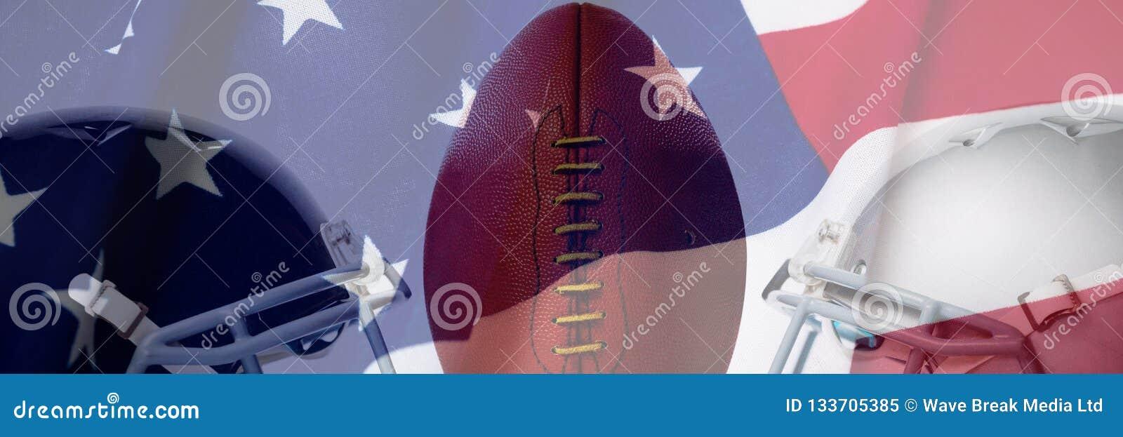 关闭的综合图象在发球区域的棕色美式足球由体育盔甲