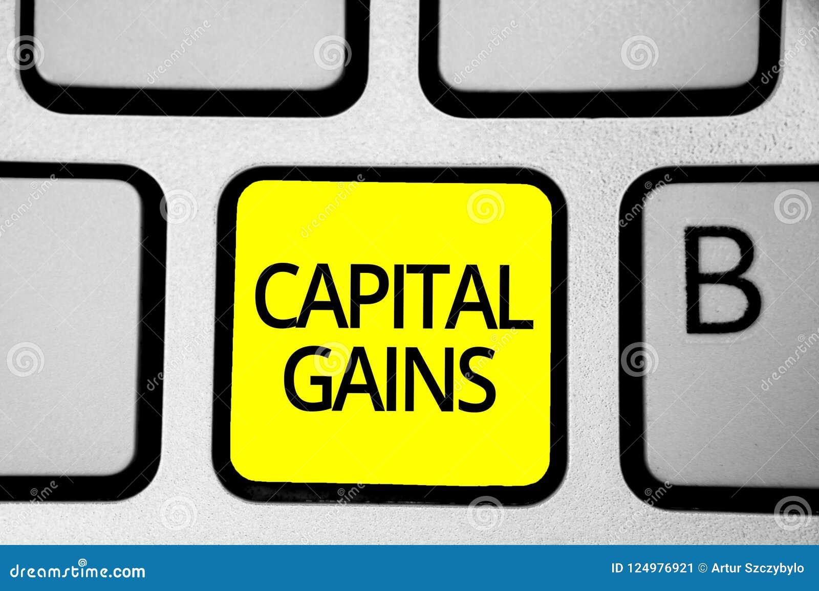 写资本收益的手写文本 概念意思债券份额股票赢利所得税投资基金键盘黄色钥匙