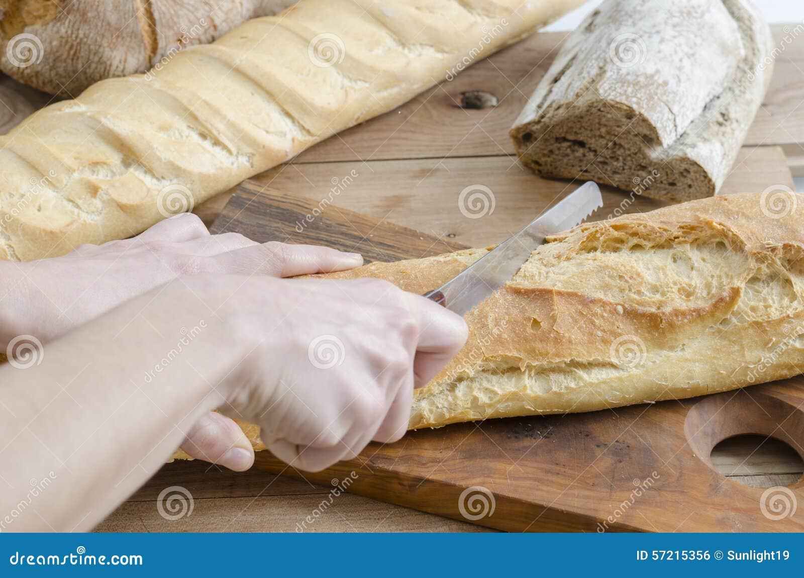 切了手的照片_切面包的女性手 库存照片 - 图片: 57215356