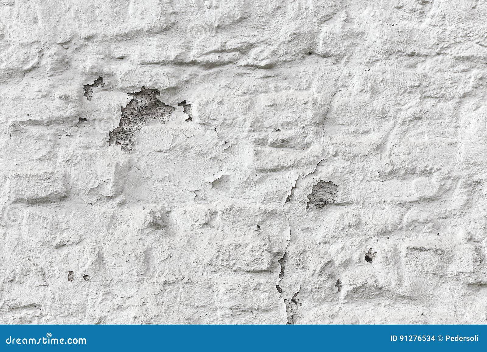 剥白色砖墙难看的东西纹理