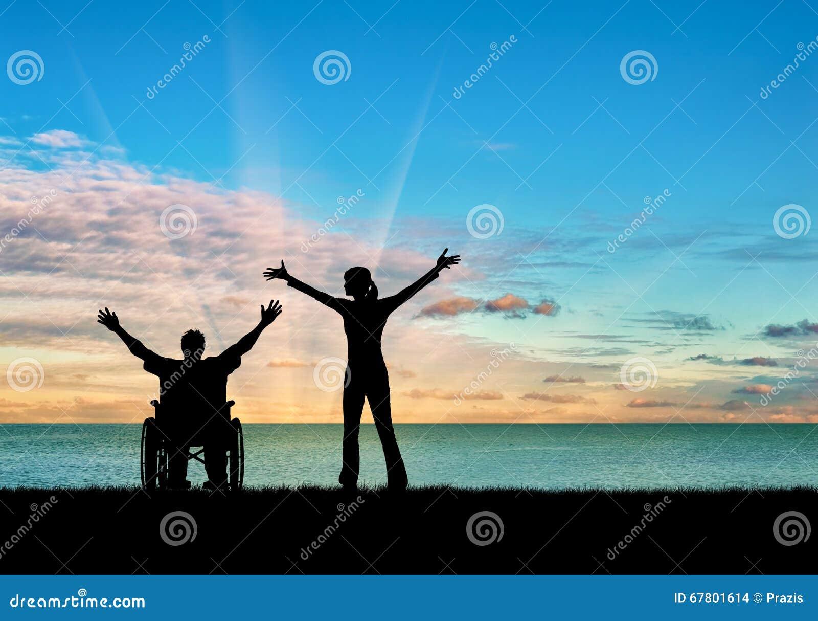 剪影愉快的残疾人和监护人