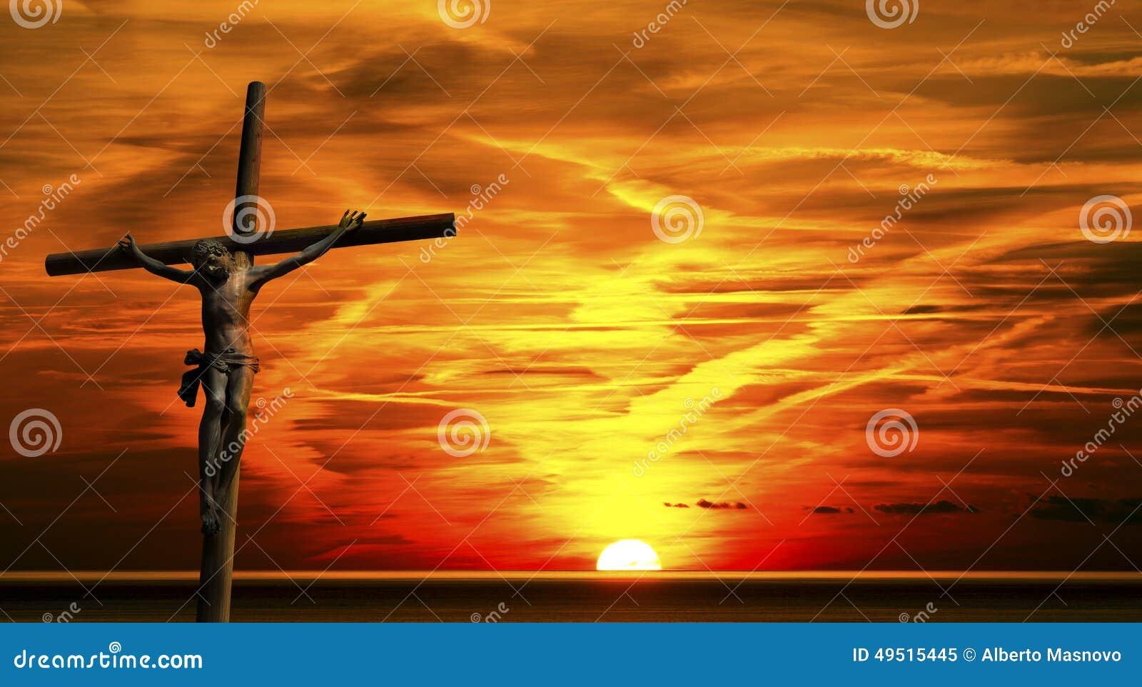 十字架的耶稣在日落