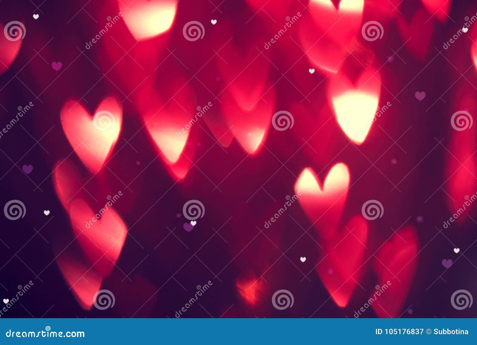 华伦泰` s日背景 与红色发光的心脏的假日背景