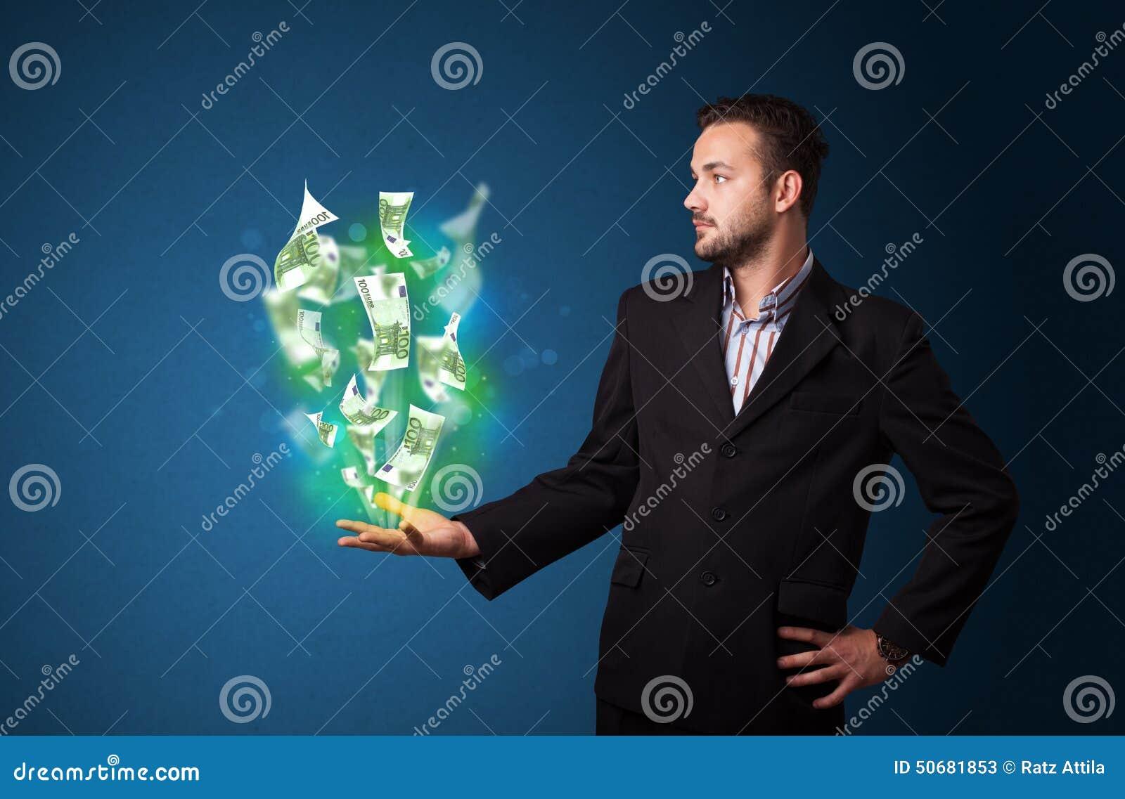 Download 发光的金钱在商人的手上 库存图片. 图片 包括有 正式, 横幅提供资金的, 广告牌, 背包, 货币, 纸张 - 50681853