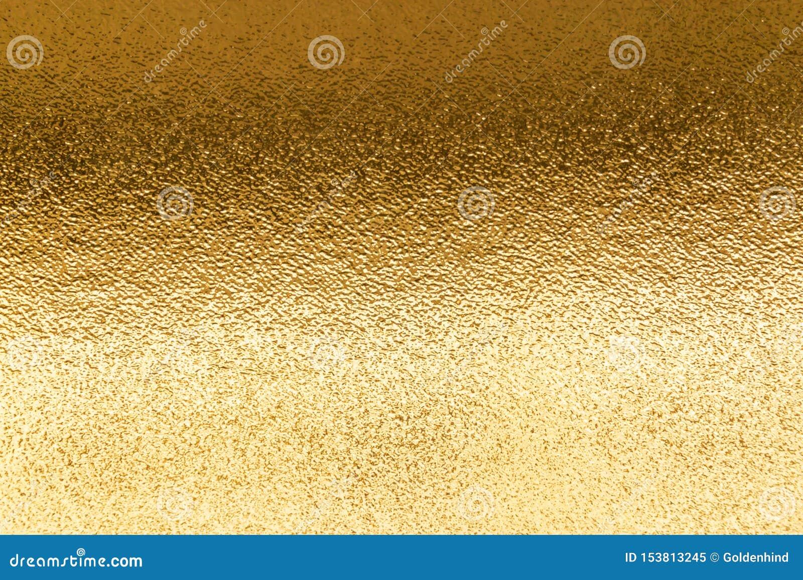 发光的黄色金属金叶箔纹理背景