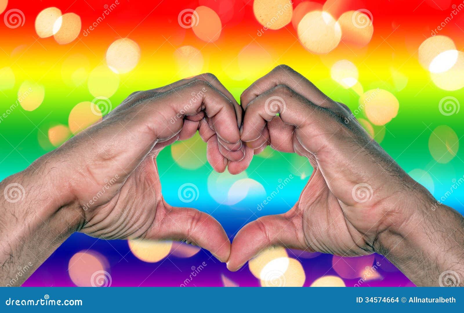 同性彩虹壁纸_同性恋婚姻,爱或者关系有做心脏的彩虹背景和手.