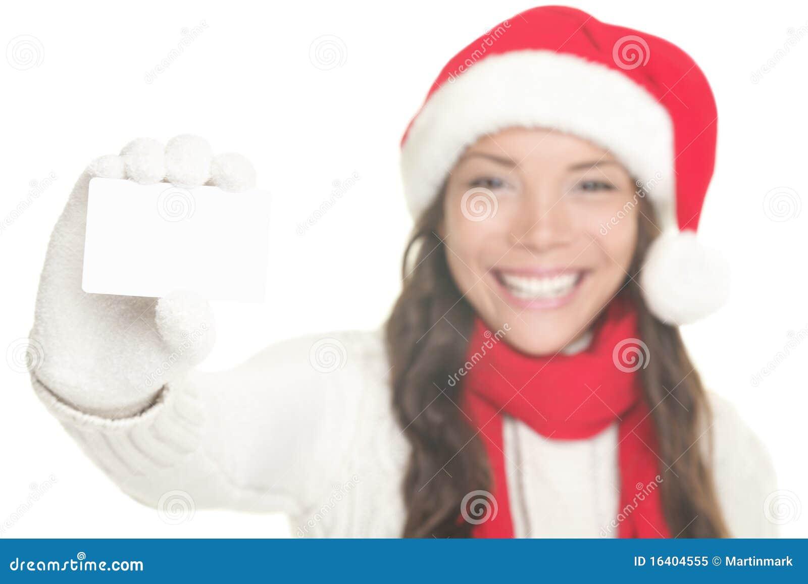 名片显示符号的圣诞节女孩