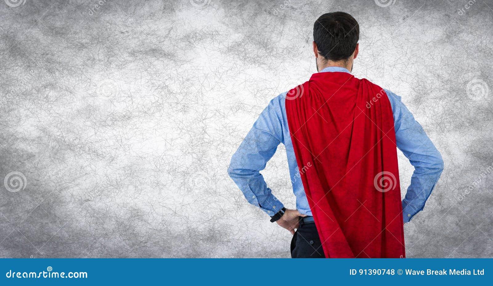 商人超级英雄用在臀部的手反对白色背景和难看的东西覆盖物