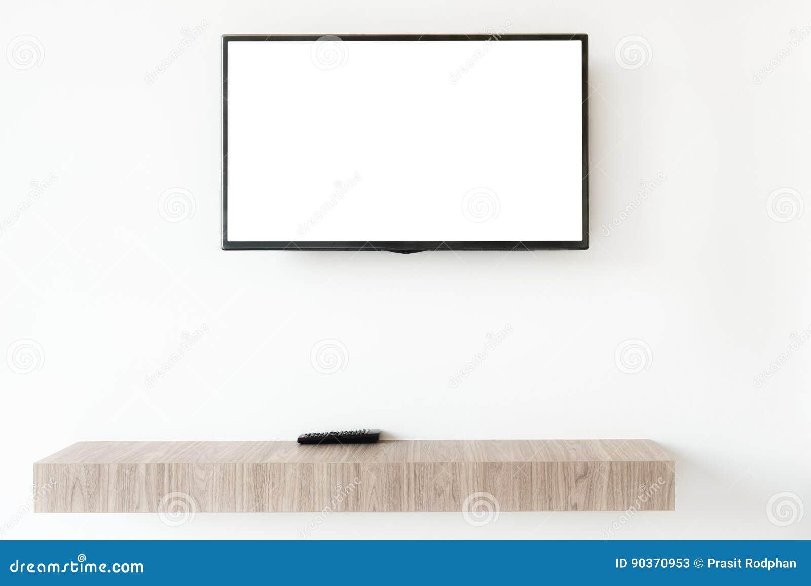 嘲笑有遥远的盘区的平的电视屏幕wwden在livin的架子