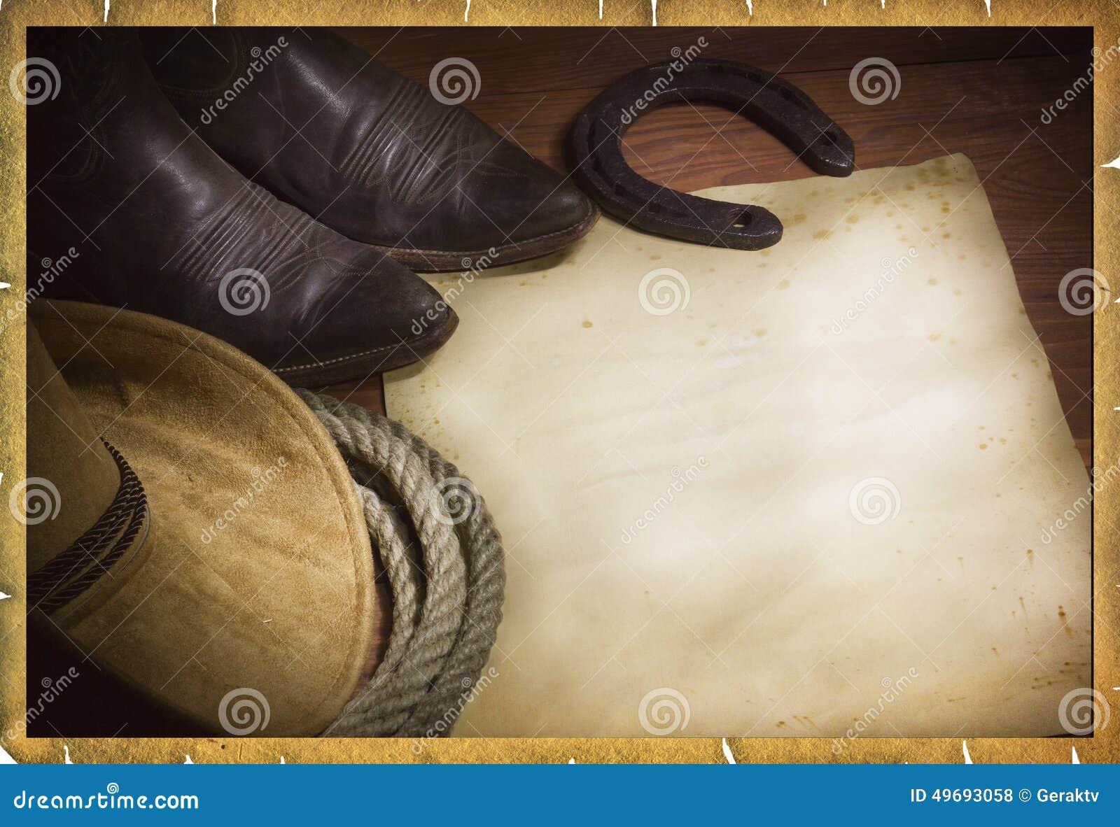 圈地与西部帽子和套索的牛仔背景