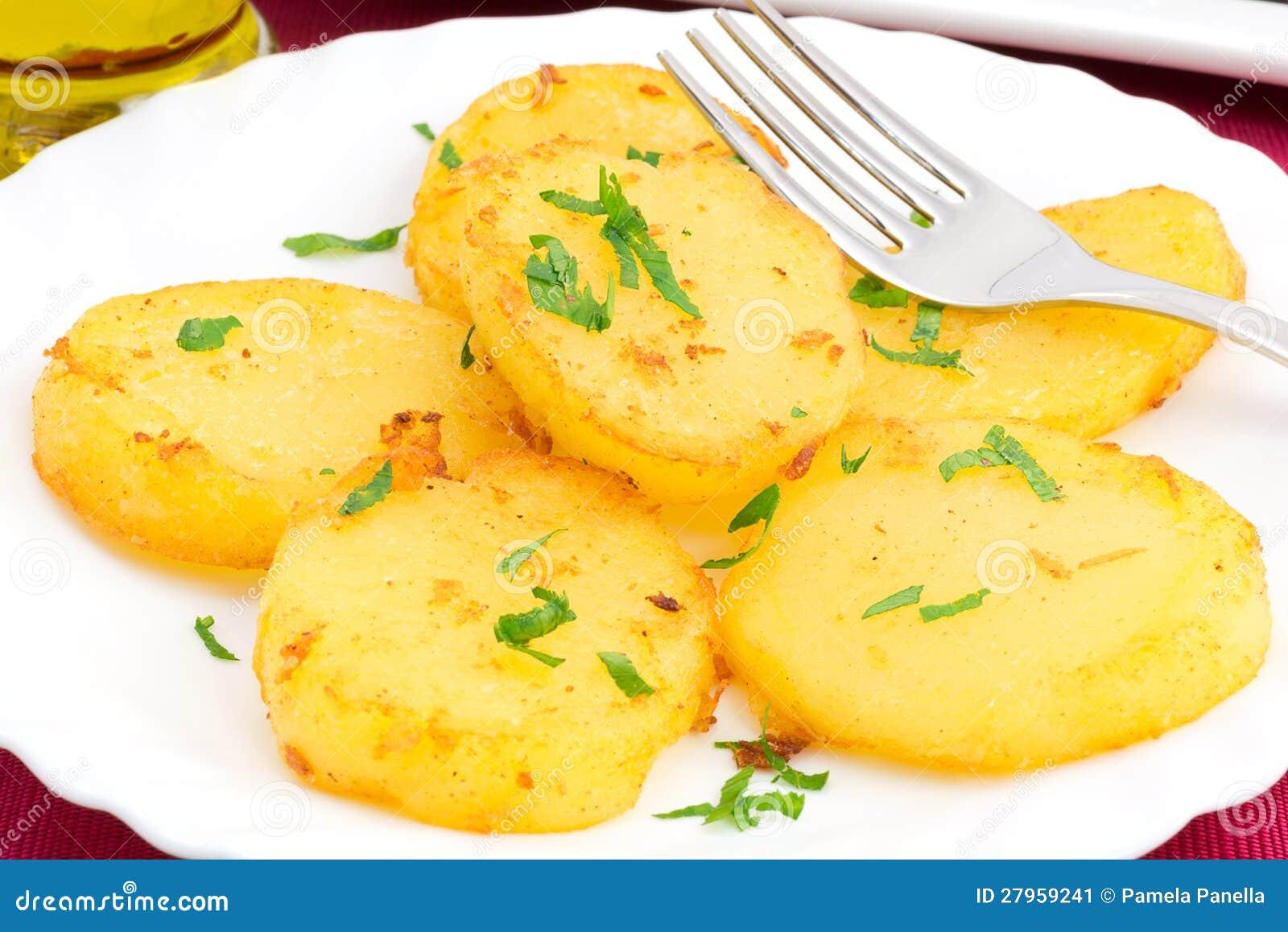 土豆磨擦用黄油和荷兰芹.图片
