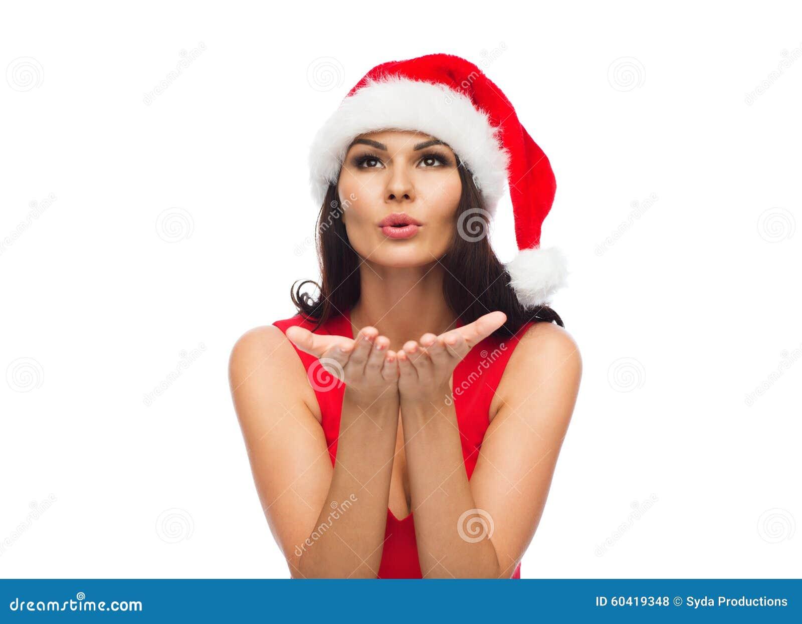 圣诞老人帽子和红色礼服的美丽的性感的妇女