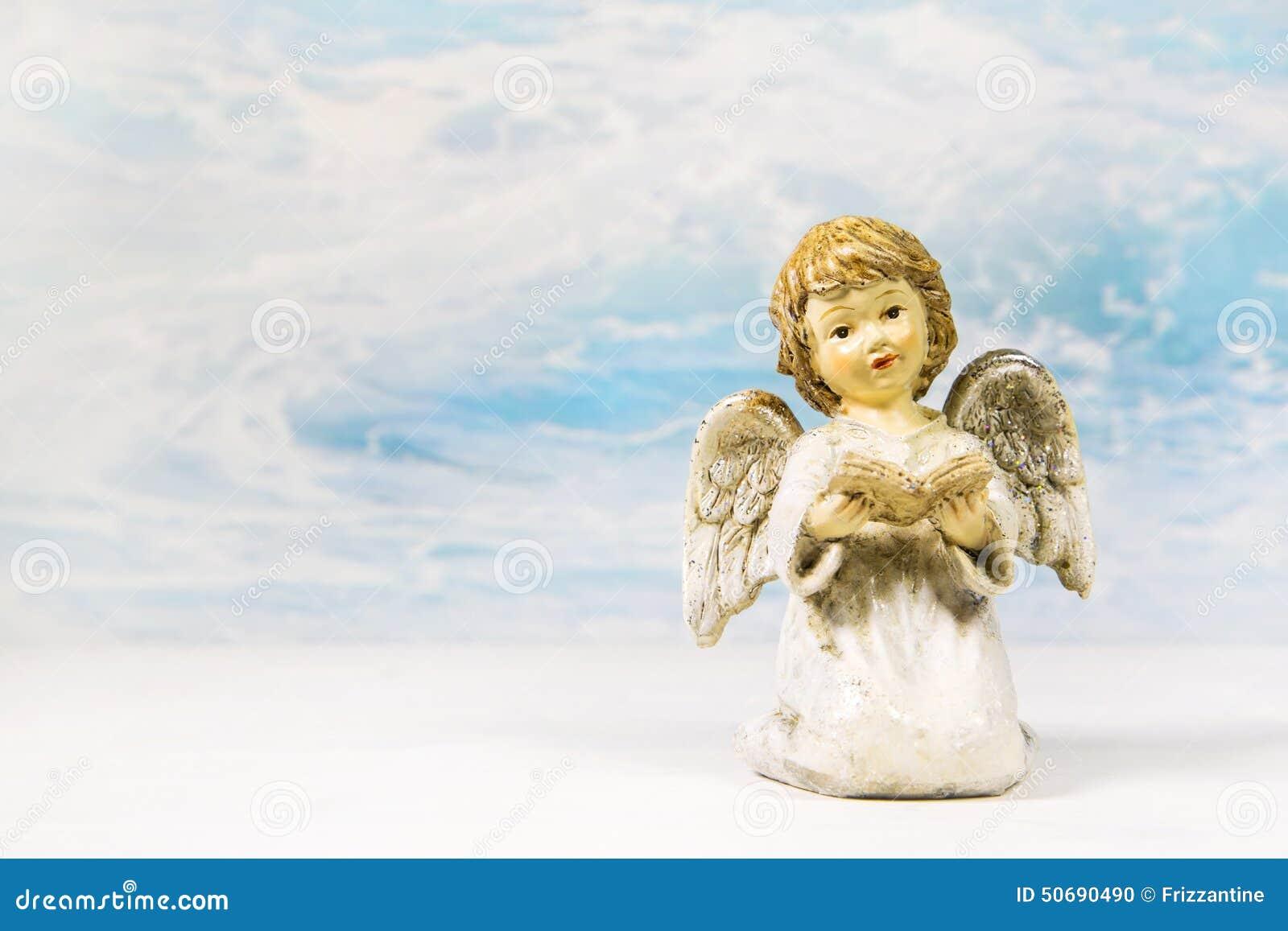 Download 圣诞节在讲的书的天使读书xmas的一个故事 库存照片. 图片 包括有 看板卡, 分娩, 装饰, 历史记录 - 50690490