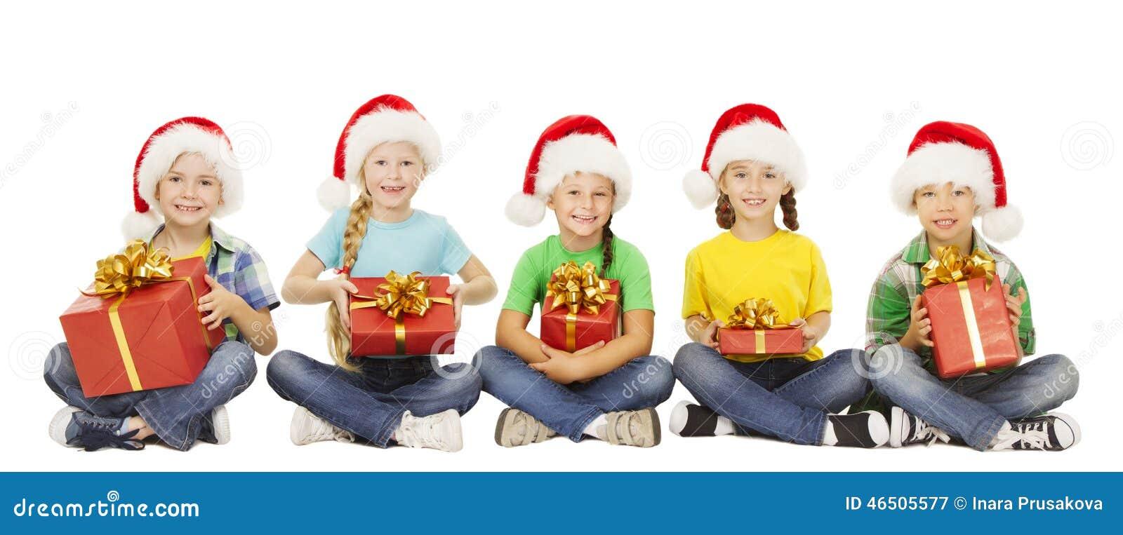 圣诞节孩子,当前礼物盒, Xmas圣诞老人帽子的孩子