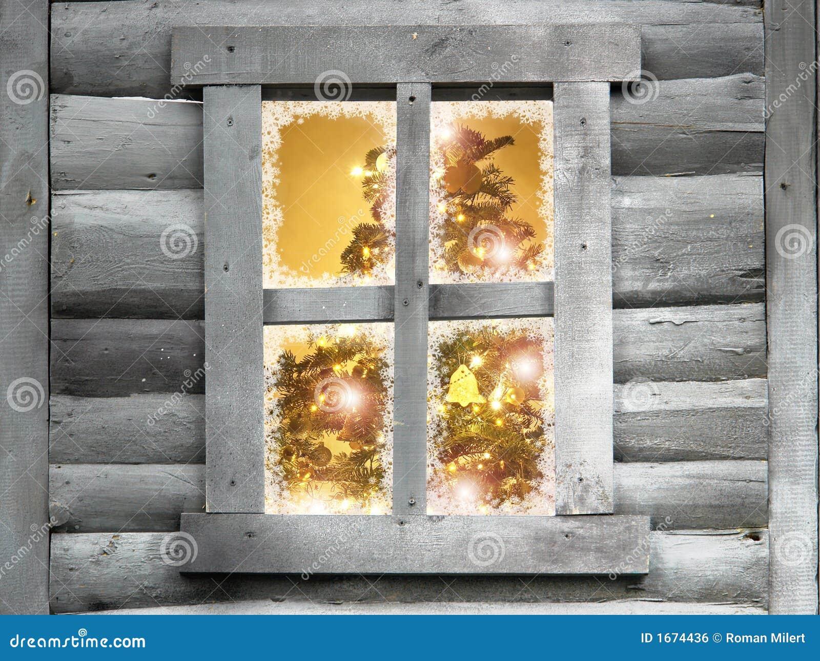 圣诞节小屋木结构树的视窗