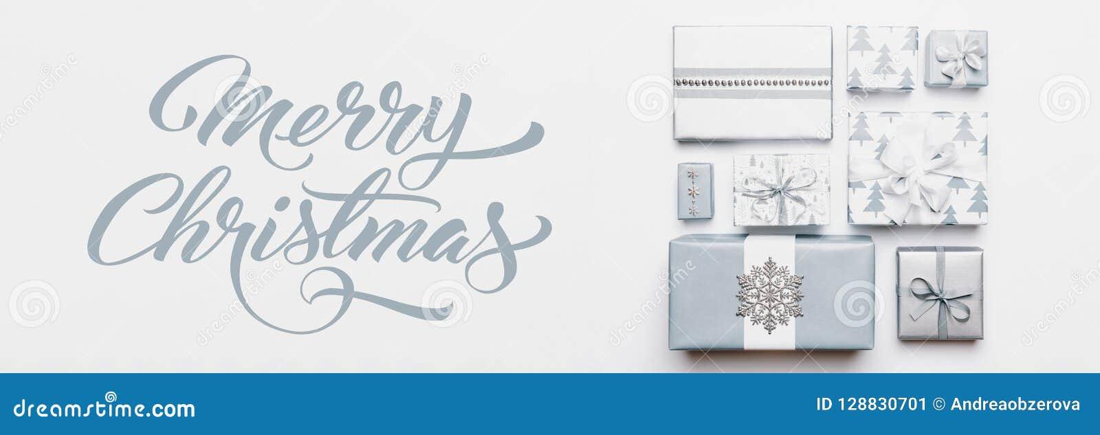 圣诞节礼物横幅 在白色背景隔绝的美好的北欧圣诞节礼物 淡色蓝色色的被包裹的xmas箱子