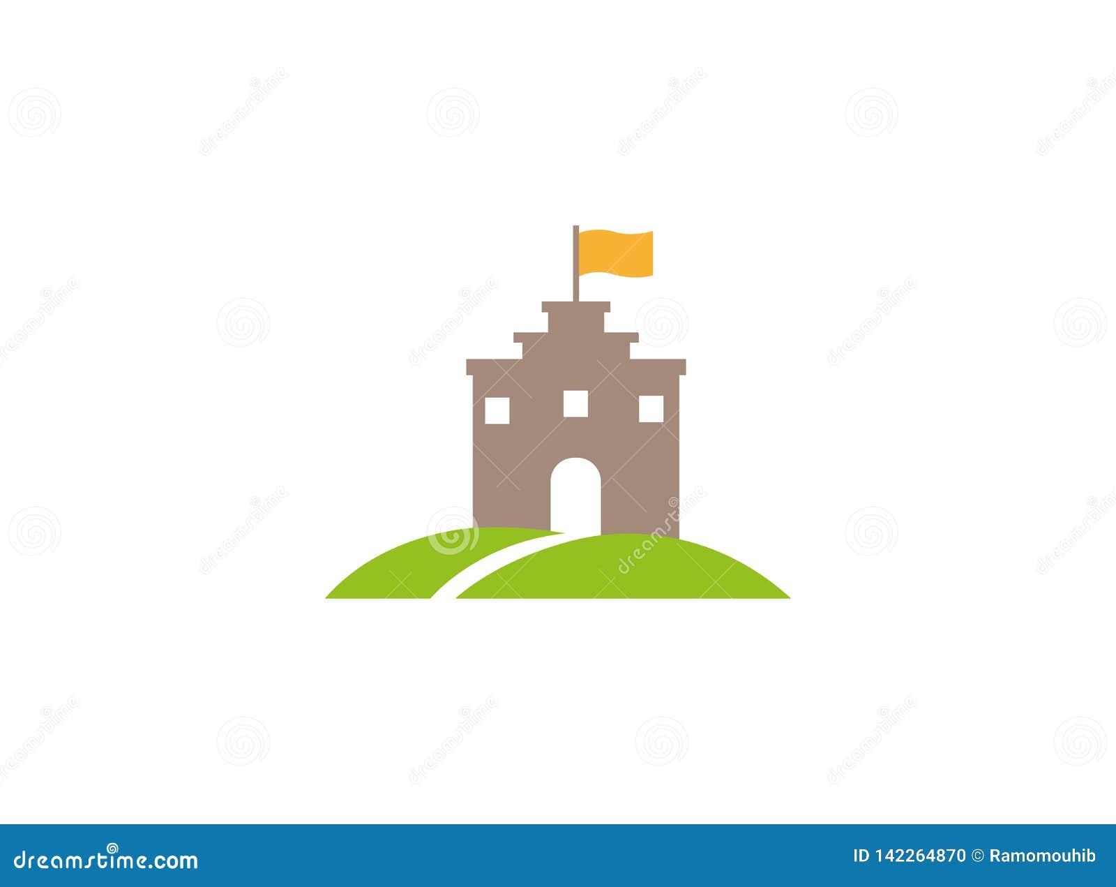 在一个绿色高原的老王宫向大门的塔与在上面的一面旗子和商标设计的路和窗口