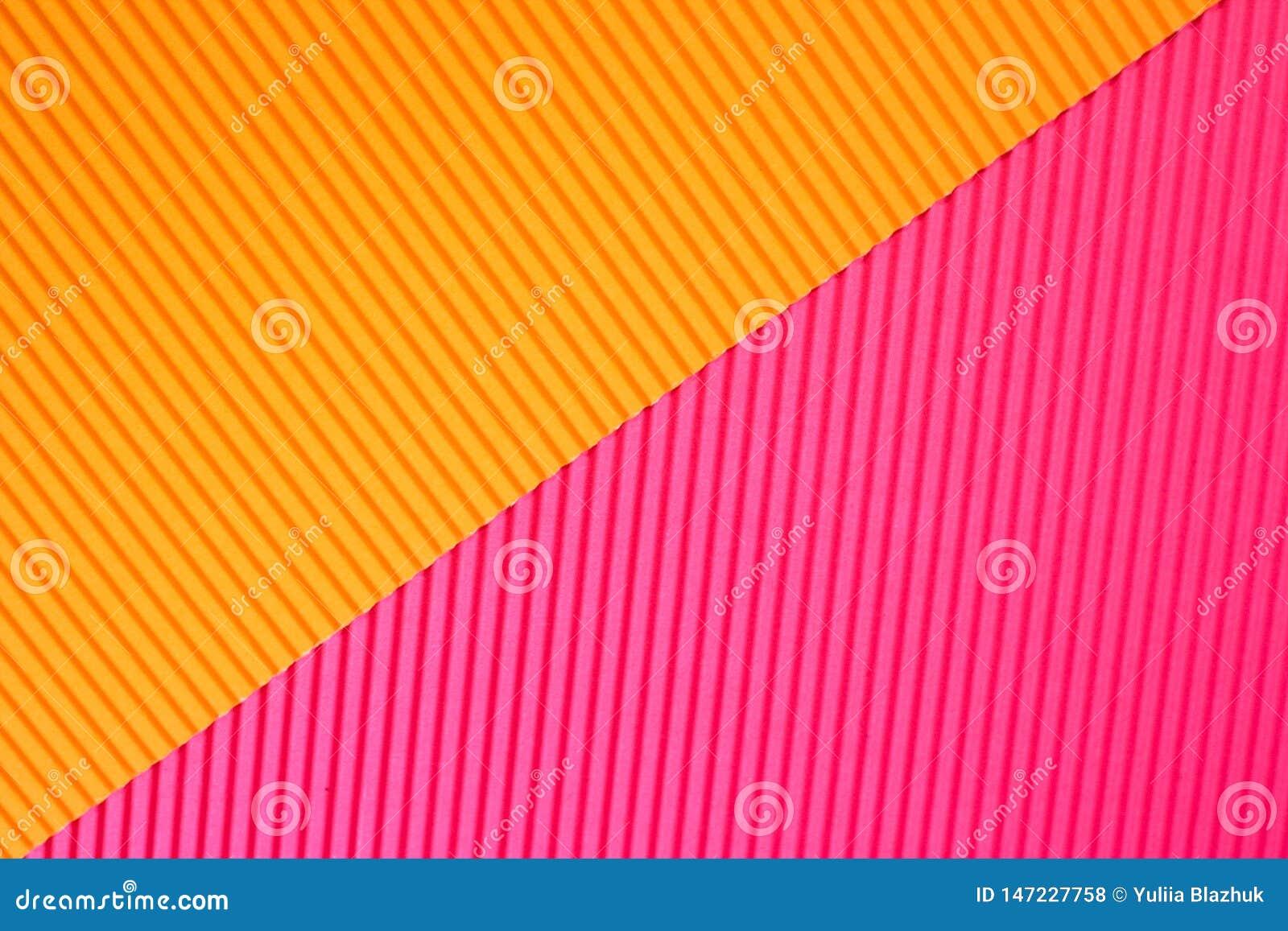 在充满活力的橙色和桃红色时髦颜色的摘要几何纸背景