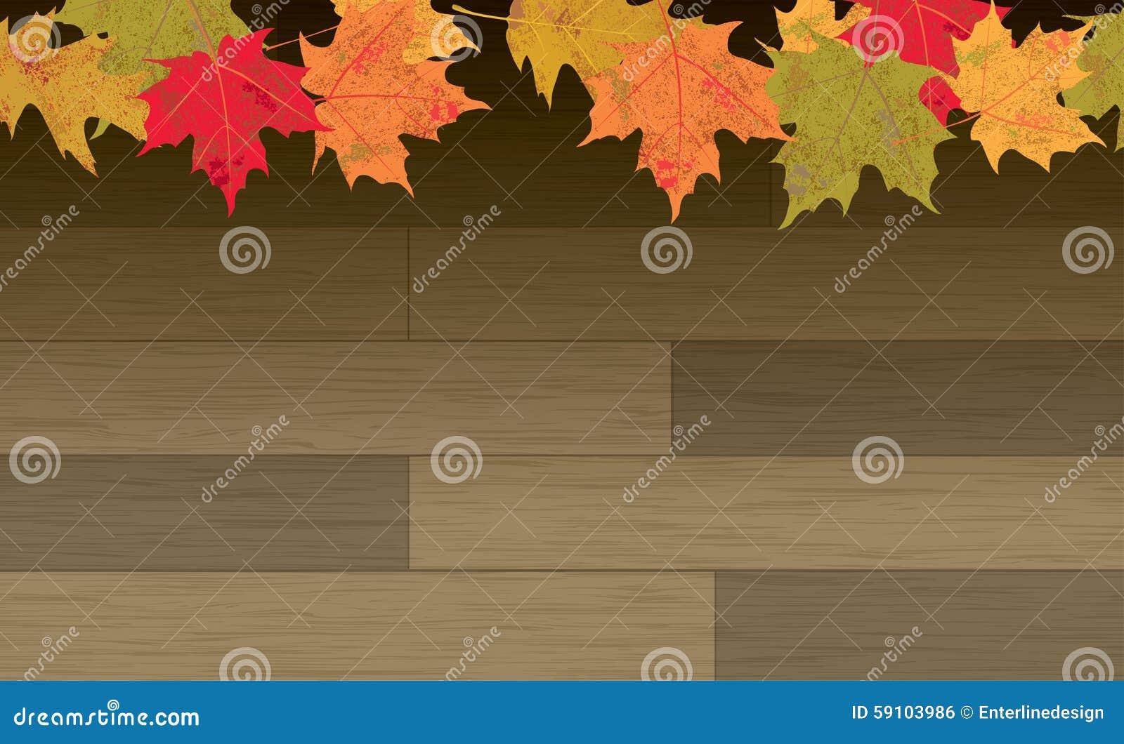 在木地板背景的秋叶