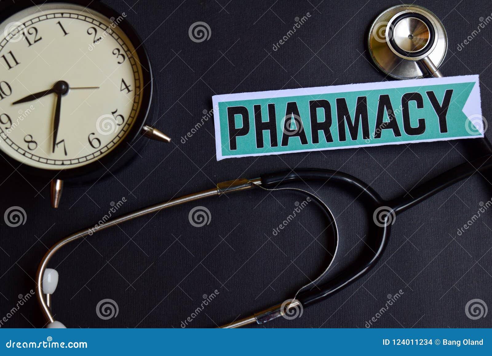 在本文的药房与医疗保健概念启发 闹钟,黑听诊器