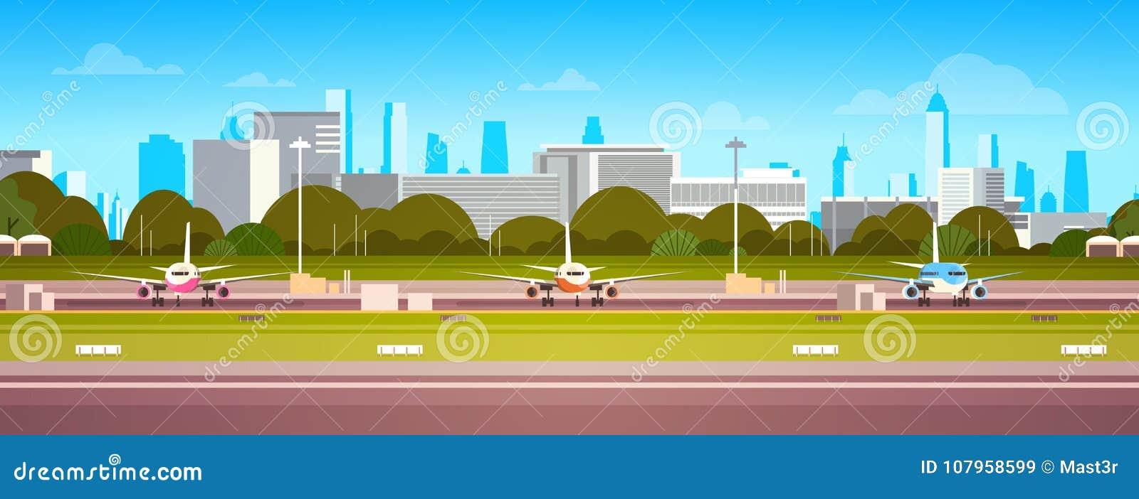 在机场大厦的飞机,有飞机的现代终端在等待的跑道离开现代城市背景