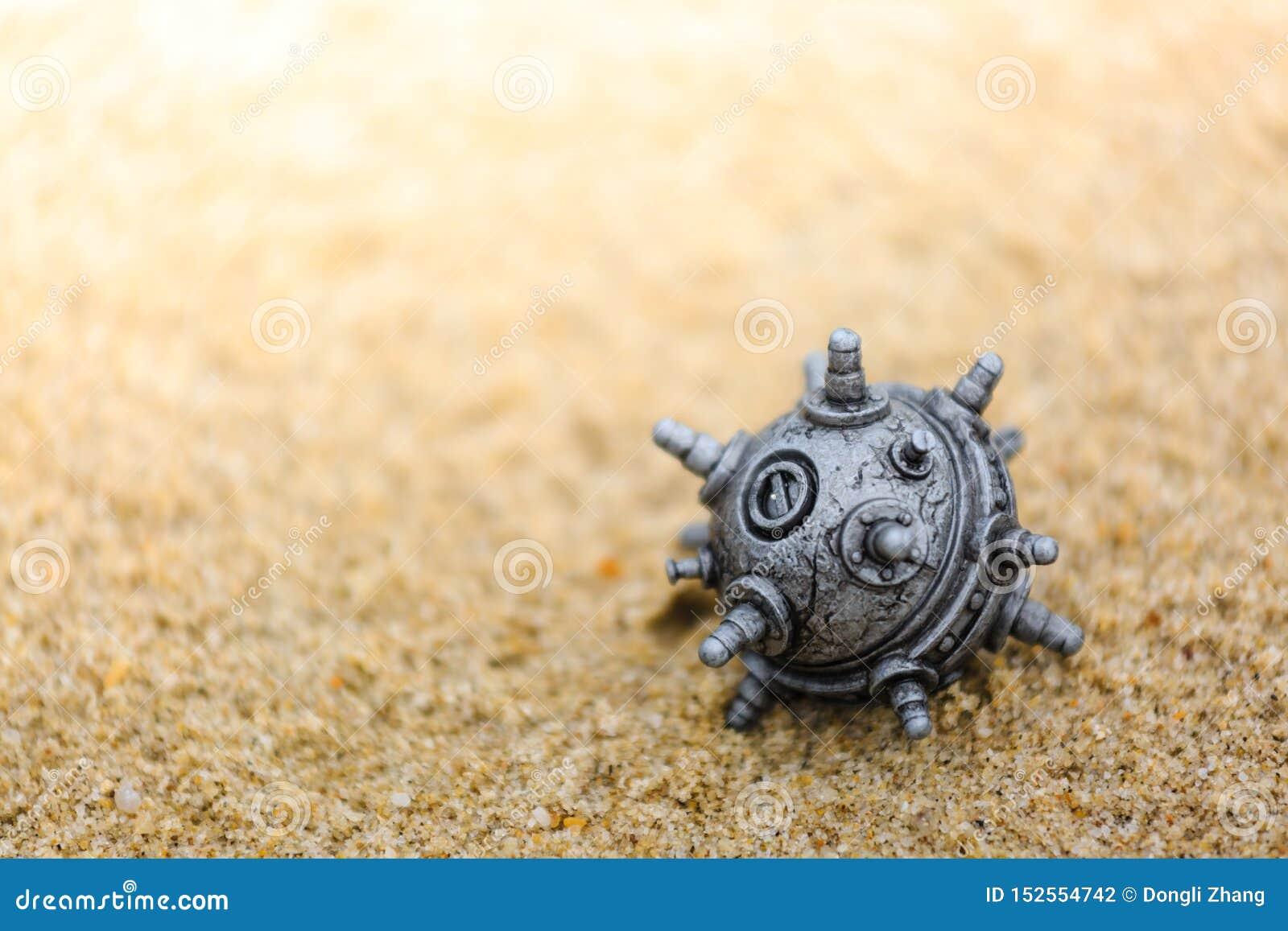 在沙子的银色颜色矿玩具