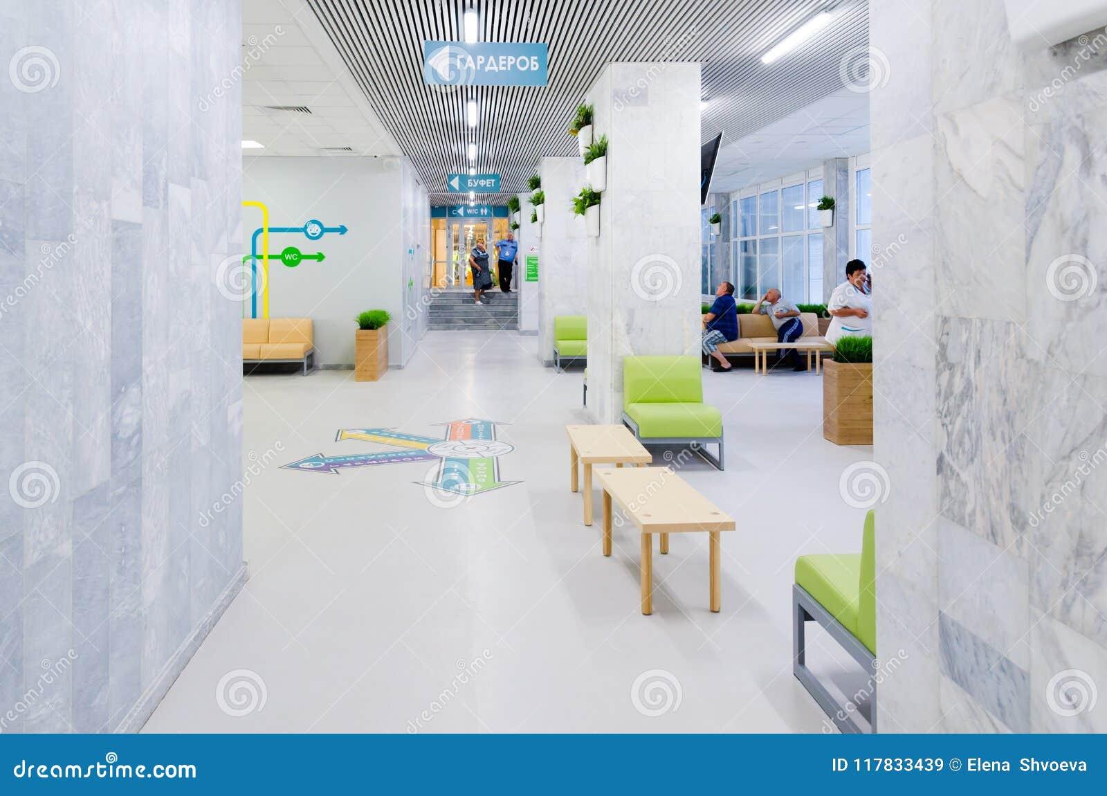 在灰色墙壁背景的鲜绿色的草在简单派样式 室内环境美化的例子 复制空间