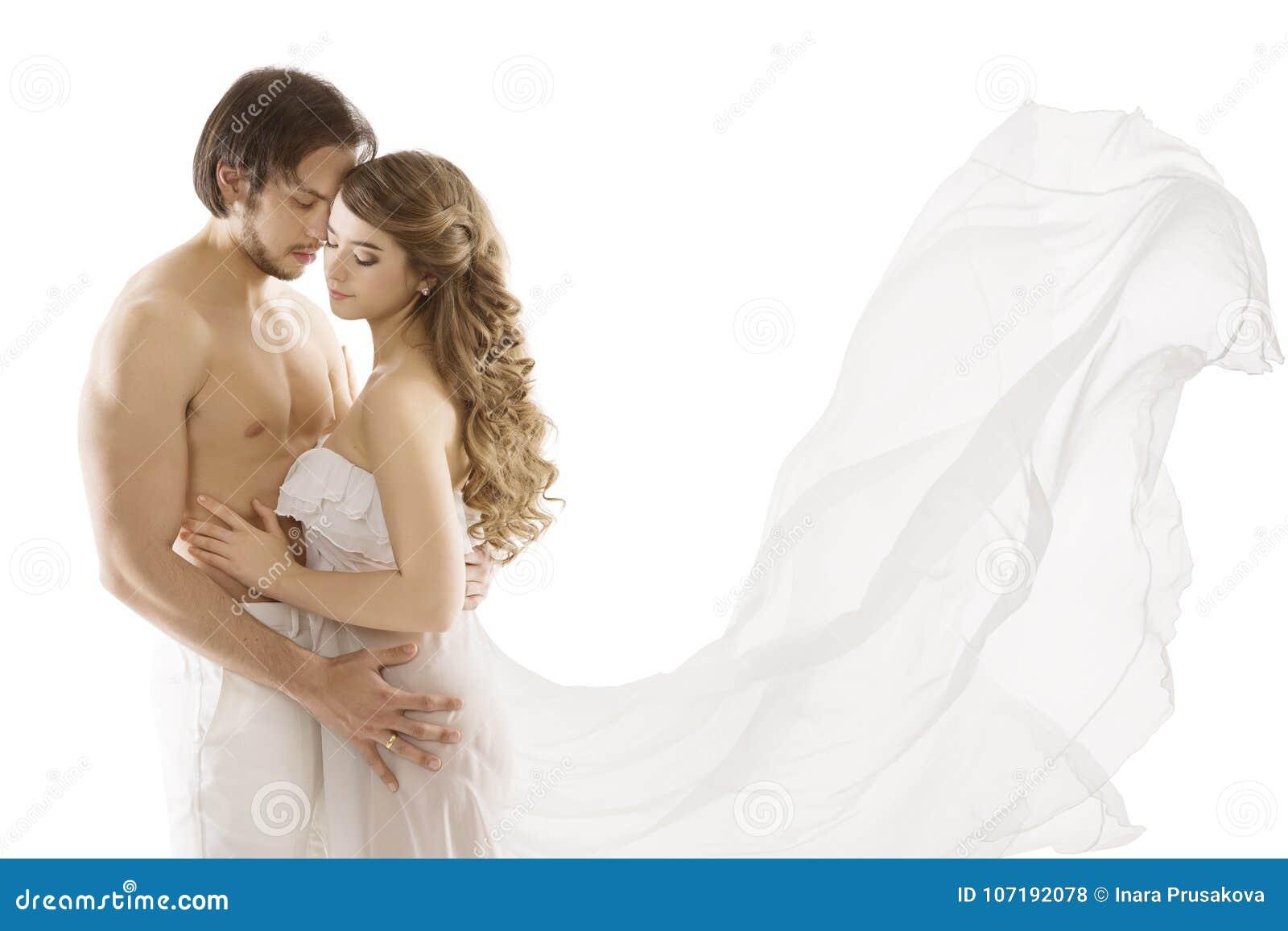 在爱的夫妇,亲吻妇女,挥动的礼服的年轻性感的人