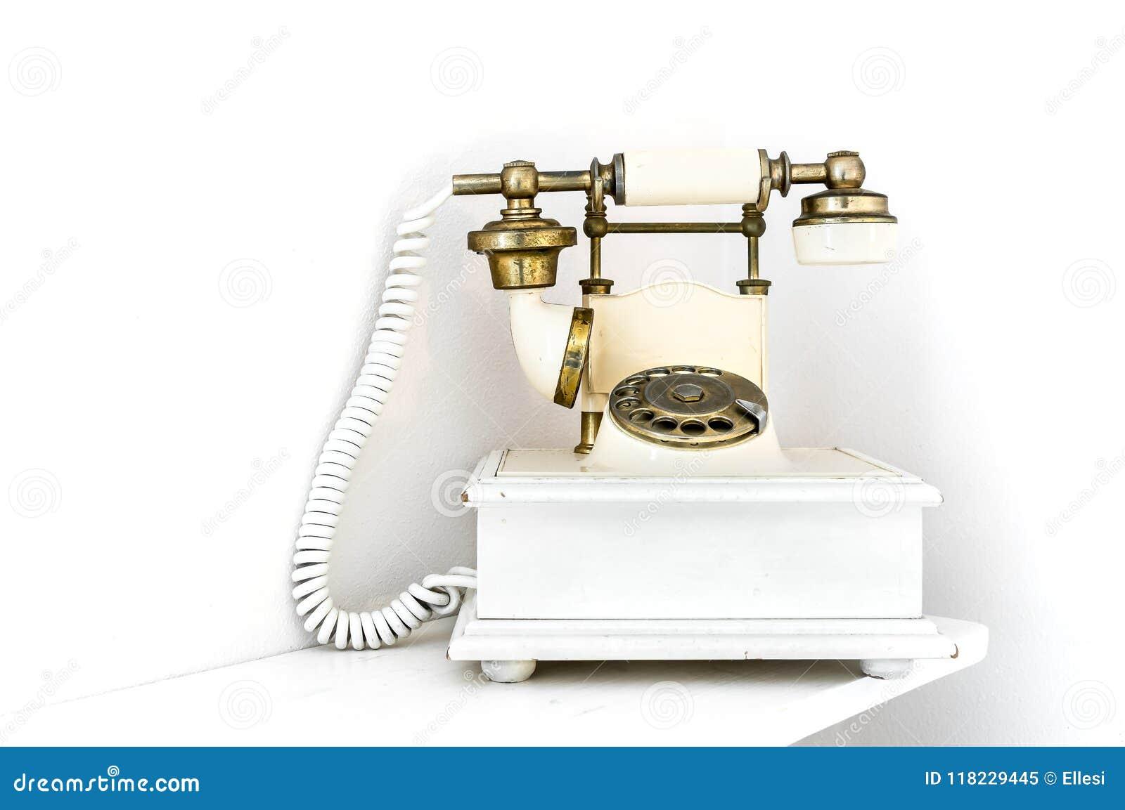 在白色背景的葡萄酒样式转台式减速火箭的电话输送路线电话