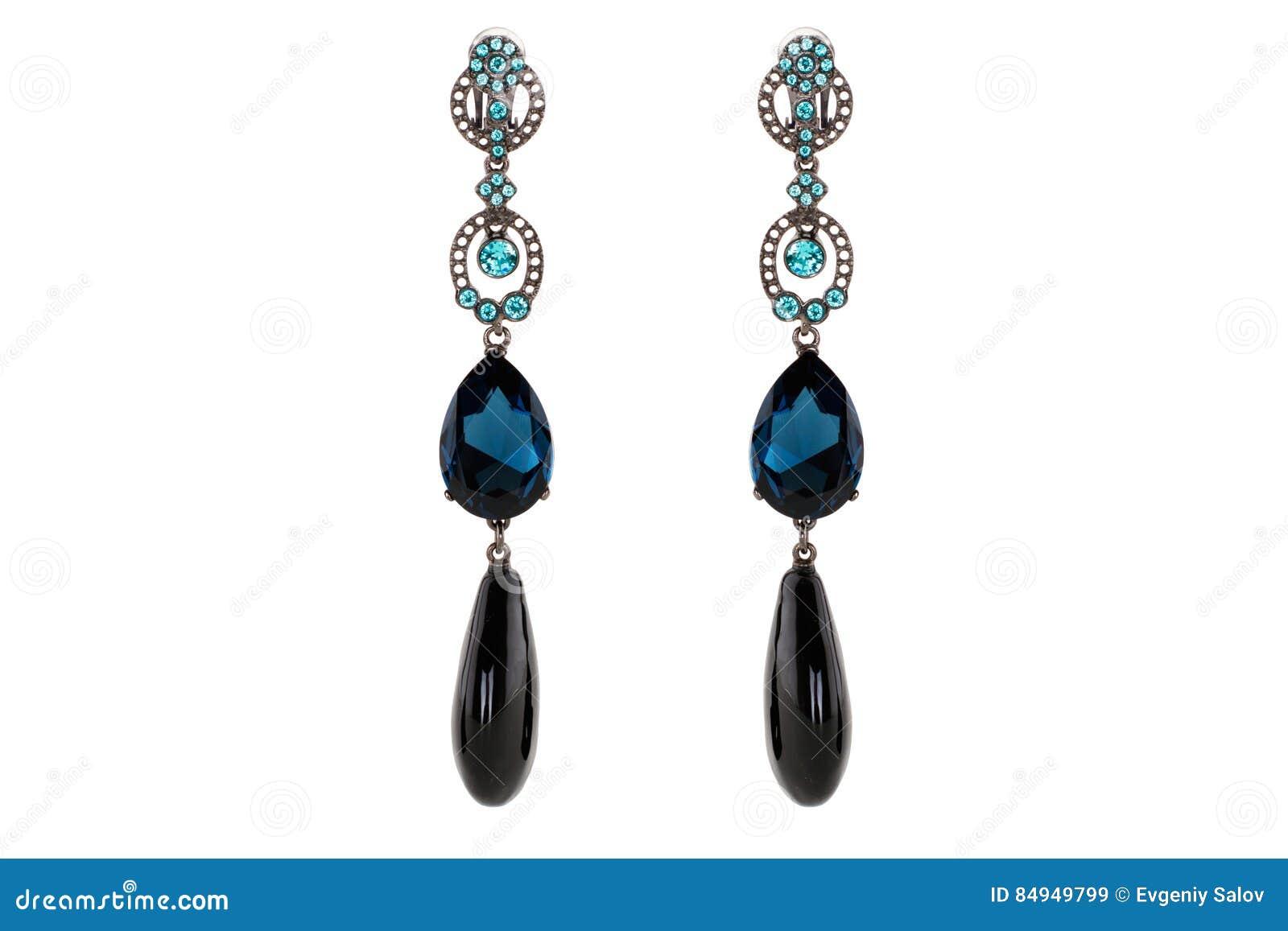 在白色背景的首饰 妇女` s耳环优质与宝石 孤立首饰 精采